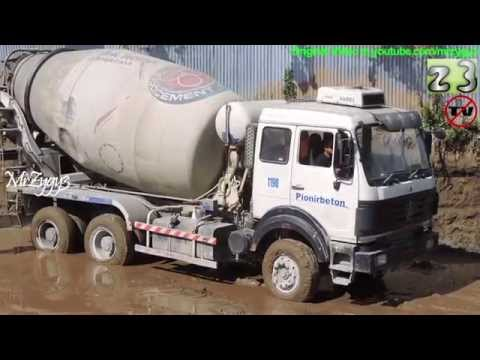 Concrete Mixer Truck Working in Mud