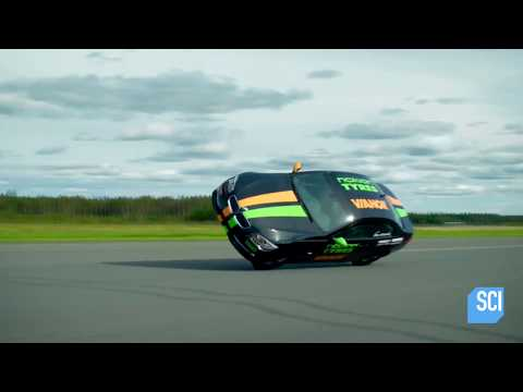 Watch This Man Set The World Speed Record While Driving His Car On Two Wheels!