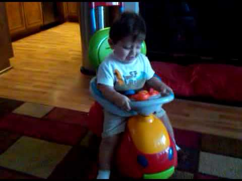 Luka driving his toy car