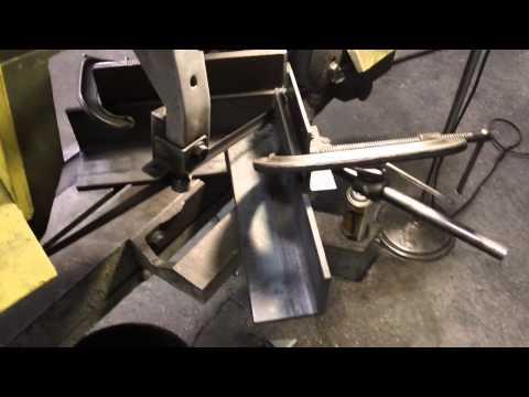 Cutting angle iron at 45 degree angles on horizontal band saw.