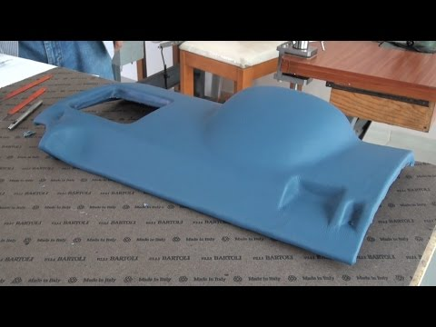 A Plastic Piece Wrapped in Leather - Auto Upholstery
