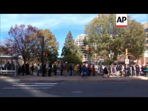 People vote in key swing state Florida, in Virginia many face long lines