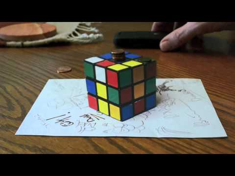 MIND BLOWING OPTICAL ILLUSION: IS THE RUBIK'S CUBE REAL? - Anamorphic Illusion