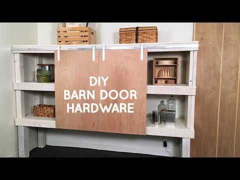 How to make DIY barn door hardware for a sliding door with only hand tools !