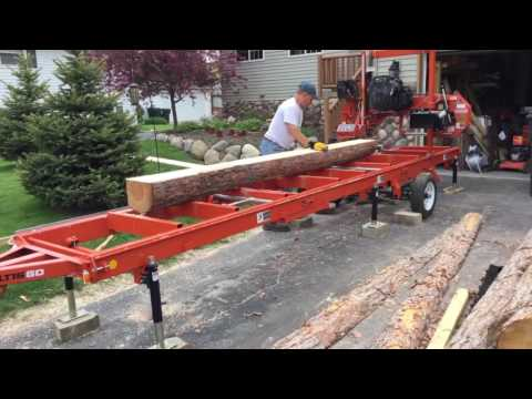 Woodmizer lt15go milling red pine log into live edge siding
