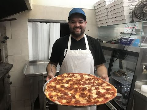 See how Paulie's Pizzeria makes its thin crust pizza