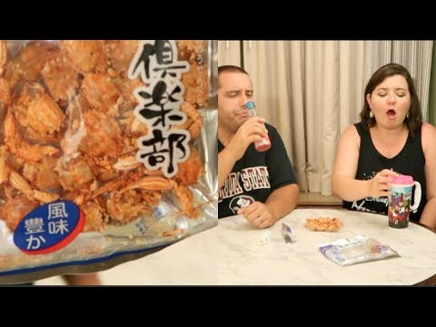 Trying WEIRDEST Snack At Epcot Dried Crab Tamagogani