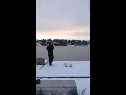 Driving golf balls on frozen Campbell lake