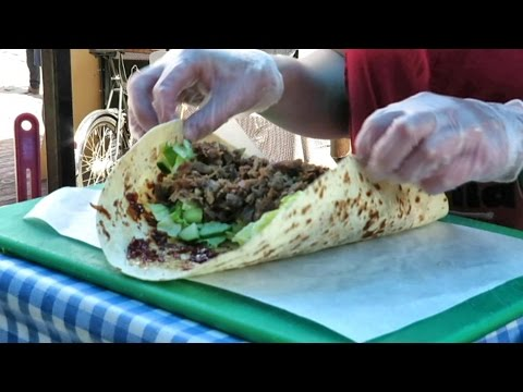 The Duck Meat Wrap with Caramel Onions. London Street Food. French Cuisine