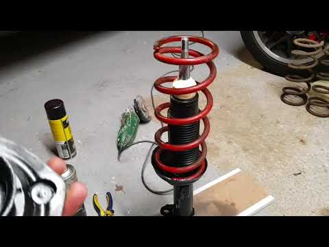 Changing shock absorber inserts.