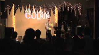 Julio Torres doing standup at the Macaulay Culkin Show (standing up)