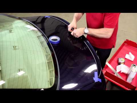 Installing a pre-painted trunk lip spoiler on a BMW
