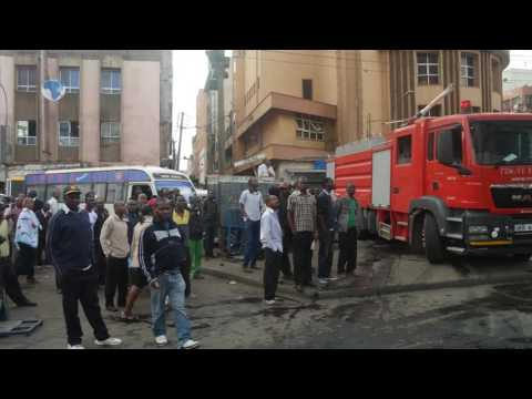 Fire fighters put out a fire that broke out at the NCM House on Tom Mboya Street in Nairobi
