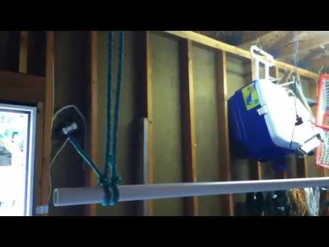 Homemade suspended clothing rack for garage sale