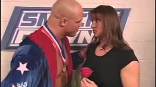 Stephanie McMahon & Kurt Angle & Brock Lesnar