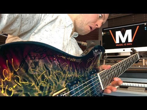 Win a PRS Mark Holcomb guitar (signed by rock stars)