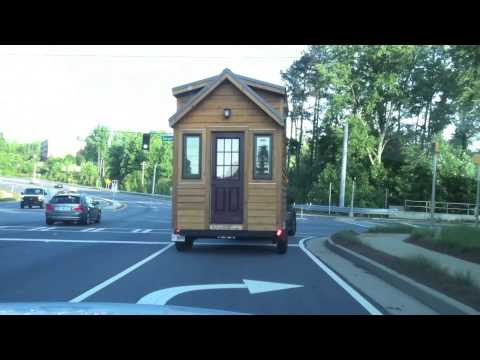 Behind a Tiny House on Wheels on the Road