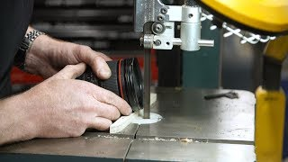 Adam Savage Removes Camera Lens Filter with Band Saw!