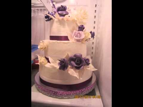 Purple, lavender and white fondant/gumpaste flowers on three tiered wedding cake