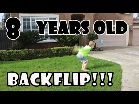 Teaching A 8 Year Old How to Backflip on Ground!!!