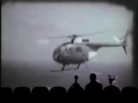 The OH 6 HELICOPTER: in a dark room played on a projector.