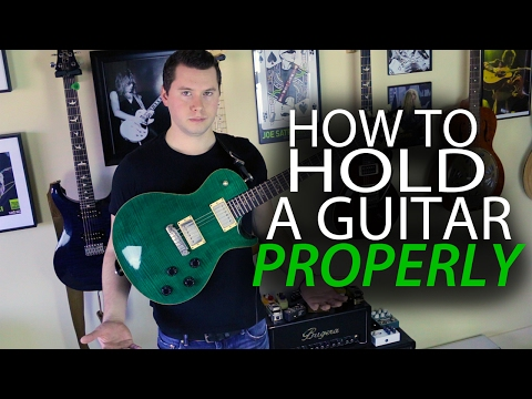 How to Hold a Guitar Properly