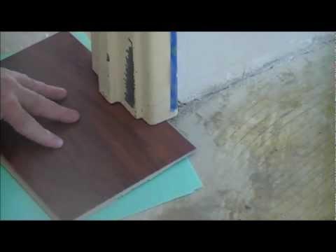 Installing laminate floors   cutting door frames