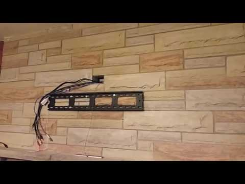 Wall mount a tv over fireplace  with NO visible wires showing