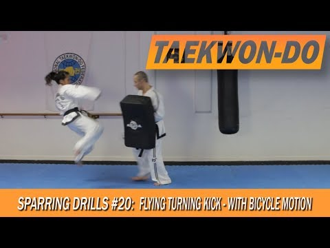 Sparring Drills #20: Flying Turning Kick - with bicycle motion.