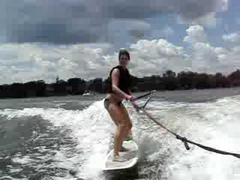 Wake Surfing behind a ski boat