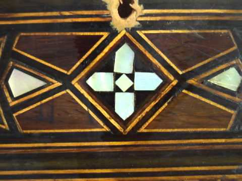 conservation treatment: cleaning old shellac on inlaid work