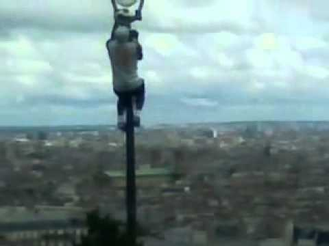 Amazing football skills  high above the streets of Gay Paris