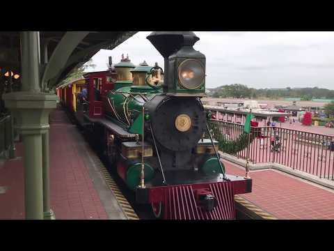 The Roger E Broggie Steam Train pulls into the Main Street Station at the Magic Kingdom