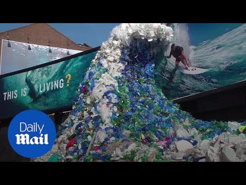 Wave appears in London made of discarded plastic for World Oceans Day - Daily Mail
