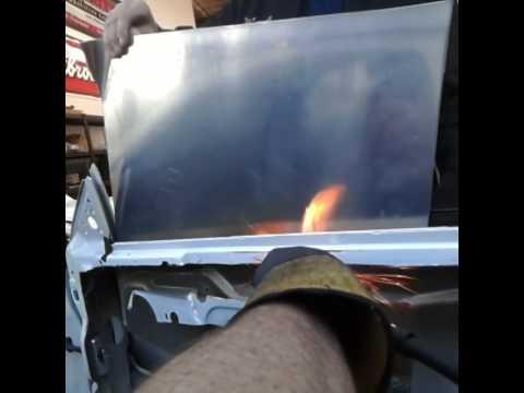 Miller Plasma cutter cutting through steel door