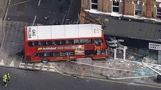 Bus crashes into shop on busy London high street