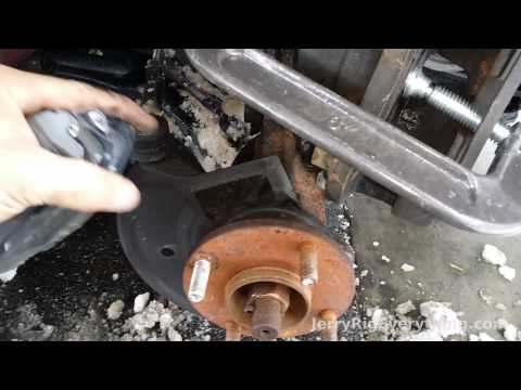 01-06 Nissan Sentra Brake Pad and Rotor Replacement Video (How to fix squeeky brakes)