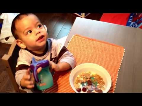 Toddler eating in his own in a toddler table