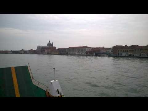 Driving past Venice with a car ferry