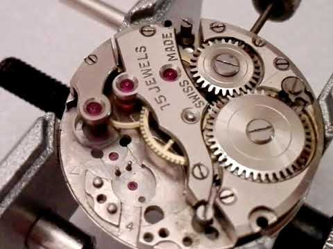 Dirty watch movement AFTER CLEANING, gear train unwinds quicker