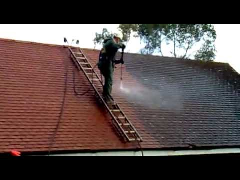 Roof Cleaning in the UK - Cleaning Moss from concrete tiles by Great Outdoors and In Ltd