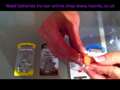 How to change the battery in a hearing aid.