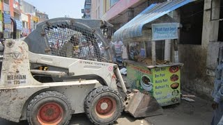 Chennai Corporation removed unauthorised shops in M.M.D.A colony