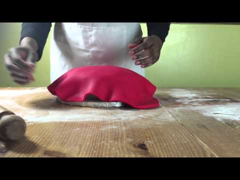 How to cover a fruit cake with fondant.