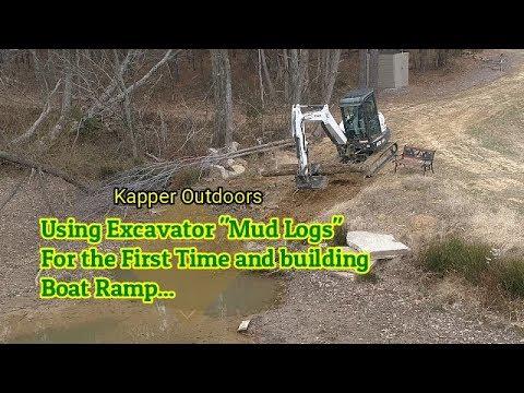 Excavator Using 'Mud Logs' and Building Boat Ramp.