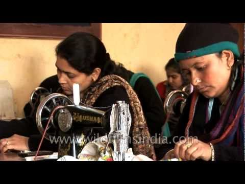 Indian women sewing with traditional machines
