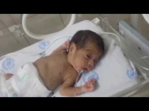 premature newborn teach to smile with nothing