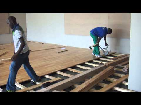 A SUNTUPS WOODEN FLOOR BEING INSTALLED IN A GYM IN SOUTH AFRICA