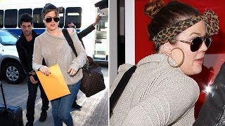 Khloe Kardashian Dodges Questions About Motherhood At LAX [2011]