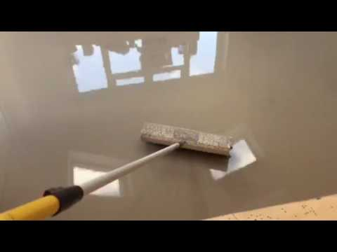 Self levelling compound and spiked roller to perfect a subfloor
